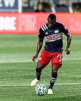 FOXBOROUGH, MA - AUGUST 29: Cristian Penilla #70 of New England Revolution passes the ball during a game between New York Red Bulls and New England Revolution at Gillette Stadium on August 29, 2020 in Foxborough, Massachusetts.