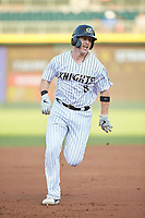 Zack Collins (8) of the Charlotte Knights hustles towards third base against the Buffalo Bisons at BB&T BallPark on July 24, 2019 in Charlotte, North Carolina. The Bisons defeated the Knights 8-4. (Brian Westerholt/Four Seam Images)