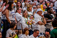 16 March 2019: A University of Vermont Catamount Fan mom protects her child's hearing as the level of cheering was high during play against the UMBC Retrievers, in the America East Championship Game at Patrick Gymnasium in Burlington, Vermont. The Catamounts defeated the Retrievers 66-49 to take the AE Championship for the 2018/2019 NCAA Men's Basketball season. Mandatory Credit: Ed Wolfstein Photo *** RAW (NEF) Image File Available ***