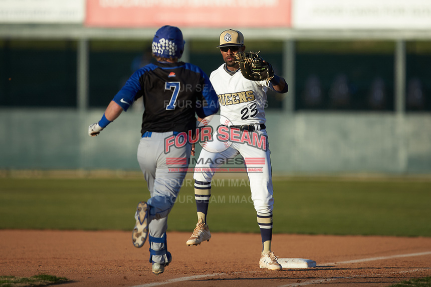 Queens Royals first baseman Noah Jones (23) prepares to tag out Gatlin Pate (7) of the Barton Bulldogs at Intimidators Stadium on March 19, 2019 in Kannapolis, North Carolina. The Royals defeated the Bulldogs 6-5. (Brian Westerholt/Four Seam Images)