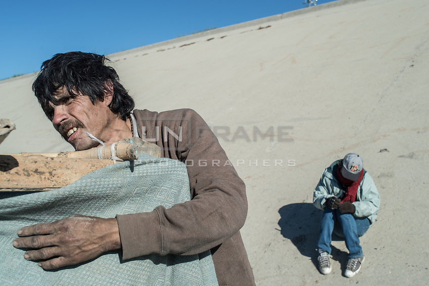Migrants living en el bordo, Tijuana after having being deported form Fresnel, USA some 5 years ago. Tijuana, Mexico. Jan 05, 2015.