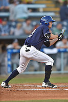 Asheville Tourists right fielder David Dahl #21 squares to bunt during a game against the Rome Braves at McCormick Field on May 1, 2014 in Asheville, North Carolina. The Tourists defeated the Braves 8-7. (Tony Farlow/Four Seam Images)