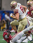 Florida State Ryan Izzo jumps over Alabama's Hootie Jones first half of the Chick-fil-A Kickoff game at the new Mercedes-Benz Stadium in Atlanta, Georgia on September 2, 2017.   Photo by Mark Wallheiser/UPI