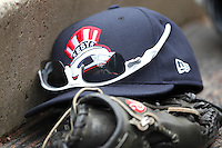 Empire State Yankees hat, glove and sunglasses in the dugout during a game against the Buffalo Bisons at Coca-Cola Field on April 12, 2012 in Buffalo, New York.  Empire State defeated Buffalo 7-2.  (Mike Janes/Four Seam Images)