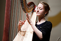 Mathilde Wauters from Belgium performs during an orchestra rehearsal for the Final Stage concert at the 11th USA International Harp Competition at Indiana University in Bloomington, Indiana on Friday, July 12, 2019. (Photo by James Brosher)