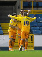 Paul Hayes (centre) of Wycombe Wanderers celebrates his goal with teammates during the FA Cup 2nd round match between Millwall and Wycombe Wanderers at The Den, London, England on 5 December 2015. Photo by Andy Rowland / PRiME