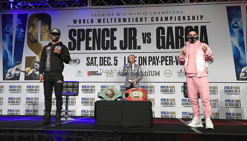 DALLAS, TX - DECEMBER 2: Errol Spence Jr. (L) and Danny Garcia appear at a press conference for their December 5, 2020 Fox Sports PBC Pay-Per-View title fight at AT&T Stadium in Arlington, Texas. They are joined on stage by announcer Jimmy Lennon Jr. (Photo by Frank Micelotta/Fox Sports)