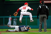 31 March 2011: Washington Nationals second baseman Danny Espinosa jumps over a sliding Brian McCann during Opening Day action against the Atlanta Braves at Nationals Park in Washington, District of Columbia. The Braves shut out the Nationals 2-0 to start off the 2011 Major League Baseball season. Mandatory Credit: Ed Wolfstein Photo