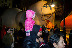 NEW YORK, NY – NOVEMBER 21: A girl on her shoulders visits the balloons of the annual Macy's Thanksgiving Day Parade the night before the parade on November 21, 2018 in New York City. (Photo by Pablo Monsalve /VIEWPress)