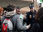 Riot police stop an anti-eviction activist  during an 'escrache'  outside popular party deputy and defense comission spokeswoman Beatriz Rodriguez-Salmones house in Madrid on April 11, 2013 in Madrid, Spain. The Mortgage Holders Platform (PAH) and other anti evictions organizations have been organizing 'escraches' for several weeks under the slogan 'There are lives at risk' to claim the vote for a Popular Legislative Initiative (ILP) to stop evictions and facilitate social rent, outside Popular Party deputies' houses and offices. 'Escraches' are a form of peaceful protest that were used in Argentine in 1995 to publically denounce pardoned members of the dictatorship for their crimes at their doorsteps(ALTERPHOTOS/Alconada)
