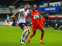 12th November 2020; Liberty Stadium, Swansea, Glamorgan, Wales; International Football Friendly; Wales versus United States of America; Matt Miazga of USA  jostles for possession with Rabbi Matondo of Wales