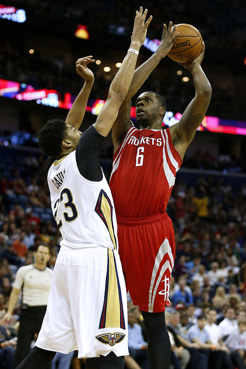 Houston Rockets forward Terrence Jones (6) shoots over New Orleans Pelicans forward Anthony Davis (23) during the first half of an NBA basketball game Saturday, Dec. 26, 2015, in New Orleans. (AP Photo/Jonathan Bachman)