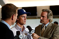 Zack Greinke is interviewed by Steve Lyons during a press conference to introduce Greinke as the newest member of the Los Angeles Dodgers at Dodger Stadium in Los Angeles, California on December 11, 2012. (Larry Goren/Four Seam Images)
