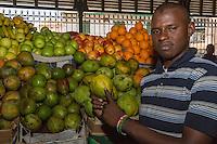 "Dakar, Senegal.  Kermel Market Vendor Showing a ""Mango Pomme."""