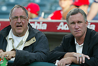 Tampa Bay Devil Rays Owner Vince Naimoli talks with Devil Rays General Manager Chuck LaMar during a 2003 season MLB game at Angel Stadium in Anaheim, California. (Larry Goren/Four Seam Images)