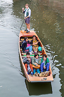 UK, England, Cambridge.  Asian Visitors in a Punt on the River Cam.