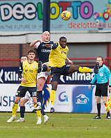 20th February 2021; Dens Park, Dundee, Scotland; Scottish Championship Football, Dundee FC versus Queen of the South; Charlie Adam of Dundee competes in the air with Nortei Nortey of Queen of the South