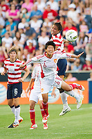Shannon Boxx (7) of the United States (USA) and Ren Guixin (6) of China PR (CHN). The United States (USA) women defeated China PR (CHN) 4-1 during an international friendly at PPL Park in Chester, PA, on May 27, 2012.