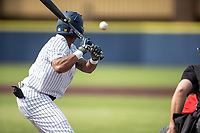 Michigan Wolverines outfielder Jordon Rogers (18) at bat during NCAA baseball action against the Ohio State Buckeyes on April 10, 2021 at Ray Fisher Stadium in Ann Arbor, Michigan. The Wolverines defeated the Buckeyes 7-0. (Andrew Woolley/Four Seam Images)