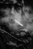 A protester smokes a cigarette inside the barricades area