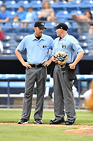 First base umpire Emil Jimenez and home plate umpire Mike Snover between innings of a game between the Lexington Legends and the Asheville Tourists at McCormick Field on May 29, 2017 in , North Carolina. The Legends defeated the Tourists 6-2. (Tony Farlow/Four Seam Images)