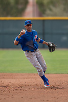 Chicago Cubs shortstop Aramis Ademan (11) evades a hard slide by Nick Allen (1) during a Minor League Spring Training game against the Oakland Athletics at Sloan Park on March 13, 2018 in Mesa, Arizona. (Zachary Lucy/Four Seam Images)