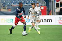 FOXBOROUGH, MA - APRIL 17: Luis Caicedo #27 of New England Revolution II brings the ball to the midfield with Matt Bolduc #7 of Richmond Kickers applying pressure during a game between Richmond Kickers and Revolution II at Gillette Stadium on April 17, 2021 in Foxborough, Massachusetts.