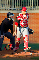 Delaware State Hornets catcher Eddie Sorondo (22) chases after a pitch in the dirt during the game against the Charlotte 49ers at Robert and Mariam Hayes Stadium on February 15, 2013 in Charlotte, North Carolina.  The 49ers defeated the Hornets 13-7.  (Brian Westerholt/Four Seam Images)