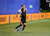 LAKE BUENA VISTA, FL - JULY 18: Eduard Atuesta #20 of LAFC tries to shield off Rolf Feltscher #25 of LA Galaxy from the ball during a game between Los Angeles Galaxy and Los Angeles FC at ESPN Wide World of Sports on July 18, 2020 in Lake Buena Vista, Florida.