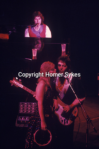 """Paul and Linda McCartney Wings Tour 1975. Paul Linda nd Denny Laine, Liverpool. England. The photographs from this set were taken in 1975. I was on tour with them for a children's """"Fact Book"""". This book was called, The Facts about a Pop Group Featuring Wings. Introduced by Paul McCartney, published by G.Whizzard. They had recently recorded albums, Wildlife, Red Rose Speedway, Band on the Run and Venus and Mars. I believe it was the English leg of Wings Over the World tour. But as I recall they were promoting,  Band on the Run and Venus and Mars in particular."""