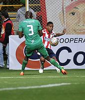 BOGOTA - COLOMBIA -25 -02-2015: Wilmer Diaz (Izq.) jugador de La Equidad disputa el balón con Macnelly Torres (Der.) jugador de Atletico Junior, durante partido entre La Equidad y Atletico Junior por la fecha 6 de la Liga Aguila I-2015, jugado en el estadio Metropolitano de Techo de la ciudad de Bogota. / Wilmer Diaz (L) player of La Equidad vies for the ball with Macnelly Torres (R) player of Atletico Junior, during a match La Equidad and Atletico Junior for the  date 6 of the Liga Aguila I-2015 at the Metropolitano de Techo Stadium in Bogota city, Photo: VizzorImage  / Luis Ramirez / Staff.