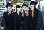 Graduates, from left, Emily Nagel, Rebecca Nelson, Jennie Quam and Alia Cox pose before the 2013 Western Nevada College Commencement at the Pony Express Pavilion, in Carson City, Nev., on Monday, May 20, 2013. .Photo by Cathleen Allison