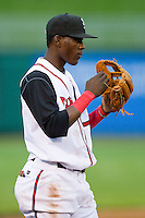 Lansing Lugnuts third baseman Gustavo Pierre (17) on defense against the Fort Wayne TinCaps at Cooley Law School Stadium on June 5, 2013 in Lansing, Michigan.  The TinCaps defeated the Lugnuts 8-5.  (Brian Westerholt/Four Seam Images)