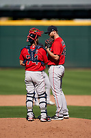 Boston Red Sox pitcher Colten Brewer (48) talks with catcher Connor Wong (74) during a Major League Spring Training game against the Atlanta Braves on March 7, 2021 at CoolToday Park in North Port, Florida.  (Mike Janes/Four Seam Images)