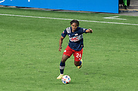 FOXBOROUGH, MA - MAY 22: DeJuan Jones #24 of New England Revolution brings the ball forward during a game between New York Red Bulls and New England Revolution at Gillette Stadium on May 22, 2021 in Foxborough, Massachusetts.