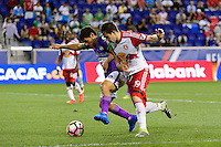 Harrison, NJ - Wednesday Aug. 03, 2016: Jose Pinto Samayoa, Alex Muyl during a CONCACAF Champions League match between the New York Red Bulls and Antigua at Red Bull Arena.