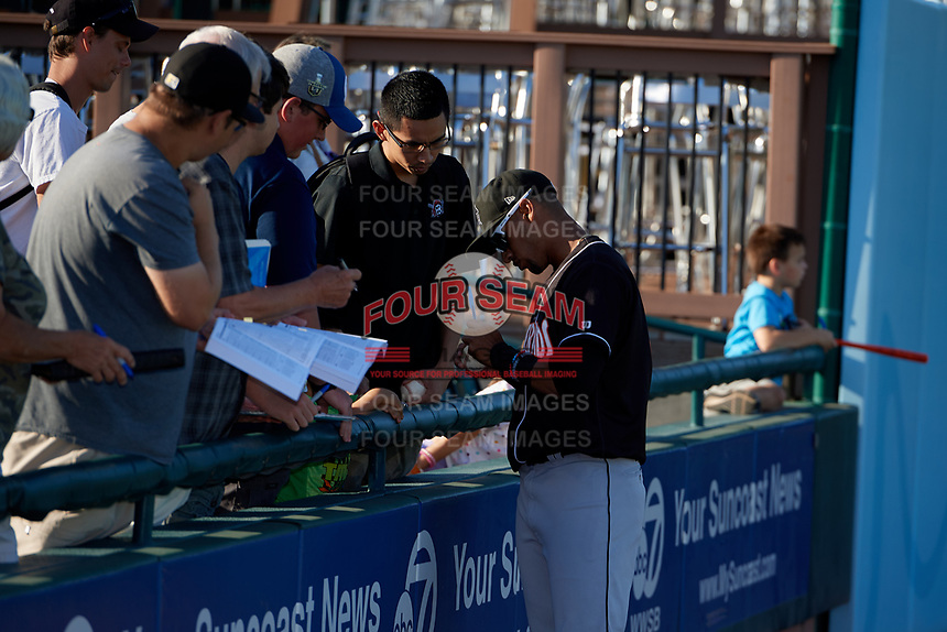 Jupiter Hammerheads Victor Victor Mesa (32) signs autographs before a Florida State League game against the Bradenton Marauders on April 20, 2019 at LECOM Park in Bradenton, Florida.  Bradenton defeated Jupiter 3-2.  (Mike Janes/Four Seam Images)