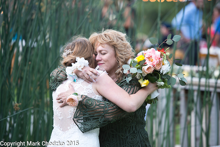 Lauren and her mother, Elaine Kelly hug.