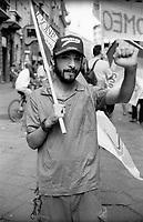 """milano, manifestazione euro mayday parade 2007. """"qual'è la tua condizione economica/lavorativa?""""  FABIO, 26 anni, impiegato alle poste --- milan, euro mayday parade 2007 demonstration. """"How is your economic and working condition?""""  FABIO, 26, post employee"""
