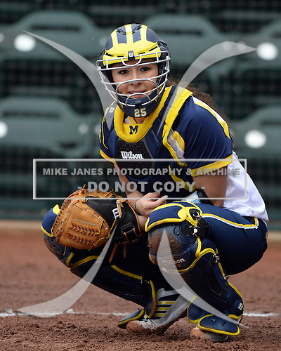 Michigan Wolverines catcher Lauren Sweet (25) looks to the bench during the season opener against the Florida Gators on February 8, 2014 at the USF Softball Stadium in Tampa, Florida.  Florida defeated Michigan 9-4 in extra innings.  (Copyright Mike Janes Photography)