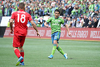 SEATTLE, WA - NOVEMBER 10: Nicolas Lodeiro #10 of the Seattle Sounders FC crosses the ball during a game between Toronto FC and Seattle Sounders FC at CenturyLink Field on November 10, 2019 in Seattle, Washington.