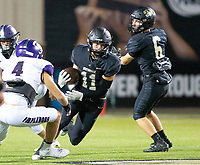 Cade Foster (11) of  Bentonville runs the ball after catch Luke Janski (4) of Fayetteville looking to make tackle at Tigers Stadium, Bentonville, Arkansas on Friday, October 16, 2020 / Special to NWA Democrat-Gazette/ David Beach