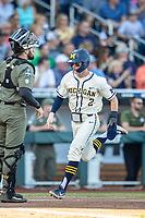 Michigan Wolverines shortstop Jack Blomgren (2) crosses the plate against the Vanderbilt Commodores during Game 1 of the NCAA College World Series Finals on June 24, 2019 at TD Ameritrade Park in Omaha, Nebraska. Michigan defeated Vanderbilt 7-4. (Andrew Woolley/Four Seam Images)
