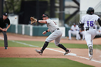 Hickory Crawdads first baseman Blaine Crim (9) waits for a throw as Yoelqui Cespedes (15) of the Winston-Salem Dash hustles down the line at Truist Stadium on July 7, 2021 in Winston-Salem, North Carolina. (Brian Westerholt/Four Seam Images)