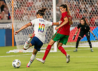 HOUSTON, TX - JUNE 10: Carli Lloyd #10 of the USWNT crosses the ball during a game between Portugal and USWNT at BBVA Stadium on June 10, 2021 in Houston, Texas.