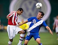 Paulo Da Silva (14) of Paraguay heads the ball away from Mario Rodriguez (10) of Guatemala during the game at RFK Stadium in Washington, DC.  Guatemala tied Paraguay, 3-3.