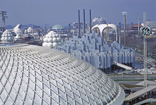 1964 World's Fair, Flushing Meadows, New York. Dome of General Electric Pavillion, foreground,  with the Tower of Light, Johnson Wax Pavillion designed by Architect Phillip Johnson and Unisphere behind on right. Photo by John G. Zimmerman.