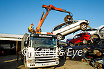 Tim Allman moving a car with the grab in Relihan's Car Dismantling and Breakers yard