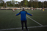 Boldmere St. Michaels 2 Worcester City 2, 16/10/2021. The Tom Brown Memorial Ground, Midland Football League Premier Division. Visiting manager Tim Harris gesturing to his team as Boldmere St. Michaels play Worcester City (in yellow) in a Midland Football League Premier Division match at the Trevor Brown Memorial Ground in Sutton Coldfield. The home club were formed in 1883 and have played in local and regional football ever since, whilst the visitors were formerly one of the leading non-League clubs in England before a move from their St. George's Lane ground in 2013 started a downward spiral in their fortunes. Worcester City won this match 2-0, with a double from Aaron Roberts, despite playing for an hour with 10 men, watched by a crowd of 169 spectators, mainly away fans. Photo by Colin McPherson.