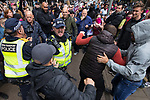 """© Joel Goodman - 07973 332324 . 11/06/2017 . Manchester , UK . Fights break out between the demonstrators and anti fascists . Demonstration against Islamic hate , organised by former EDL leader Tommy Robinson's """" UK Against Hate """" and opposed by a counter demonstration of anti-fascist groups . UK Against Hate say their silent march from Piccadilly Train Station to a rally in Piccadilly Gardens in central Manchester is in response to a terrorist attack at an Ariana Grande concert in Manchester , and is on the anniversary of the gun massacre at the Pulse nightclub in Orlando . Photo credit : Joel Goodman"""